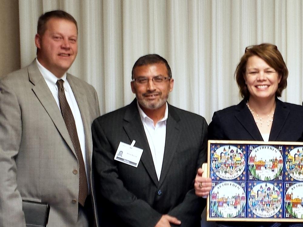 Dr. Abed Ayoub (center)