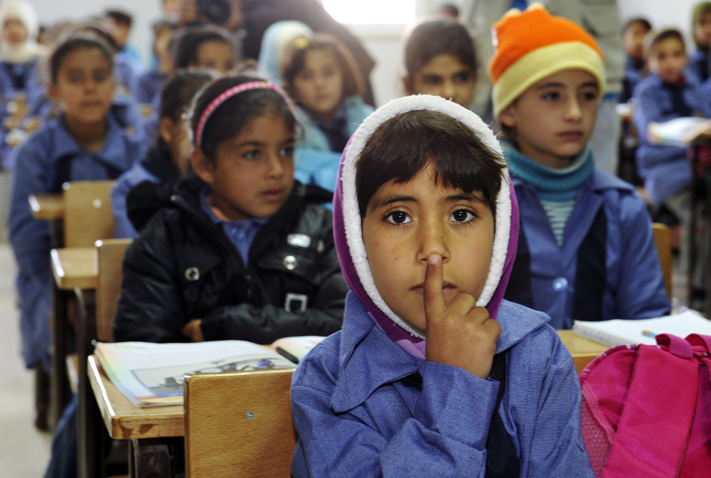 Children inside a classroom at Za'atri refugee camp. UN Photo/Mark Garten